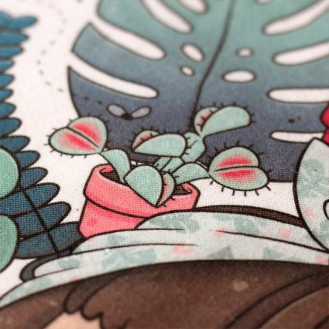 detalle de la impresión de un bolso de tela para amantes de las plantas